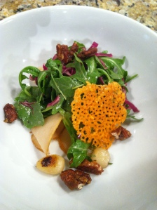 Arugula and Red Cabbage Salad with Maple Vinegrette, Roasted Pears, Caramelized Pearl Onions, Candied Walnuts, and Cheddar Chip