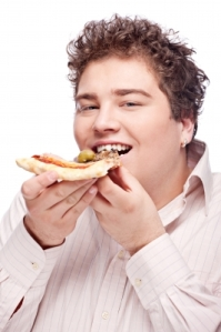 Random chubby guy eating pizza. Ooohhh the irony...